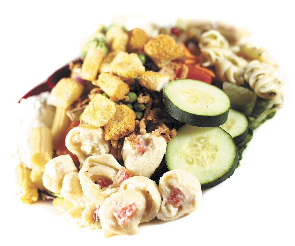 Create your own lunch at  the Rocky Rococo salad bar. - YOUNG KWAK