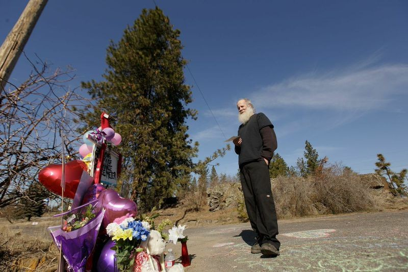 Dan Meier, Meier's husband, stands at the memorial at the accident site. - YOUNG KWAK PHOTO