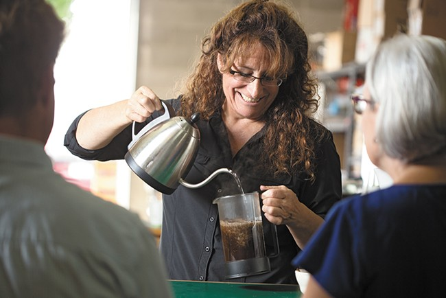 Deborah Di Bernardo prepares French press coffee at Roast House. - YOUNG KWAK