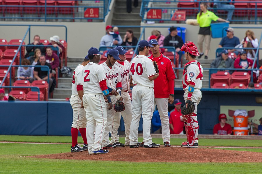 Derek Thompson (40) and Jose Jaimes, the pitching coach, gather with the infield players on the pitching mound. - MATT WEIGAND