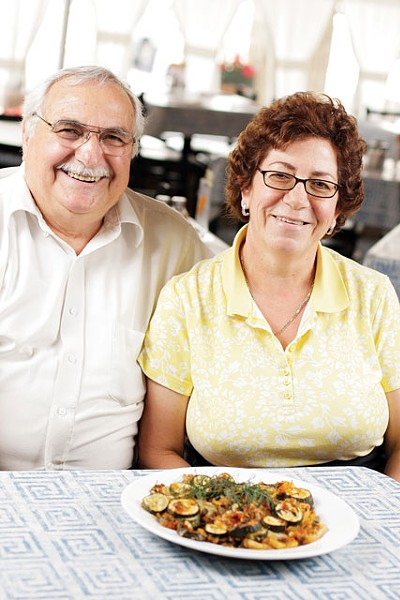Dino and Fotini Tsakarestos with their zucchini-and-potato casserole at Santorinis Greek Cuisine in Coeur d'Alene. - YOUNG KWAK