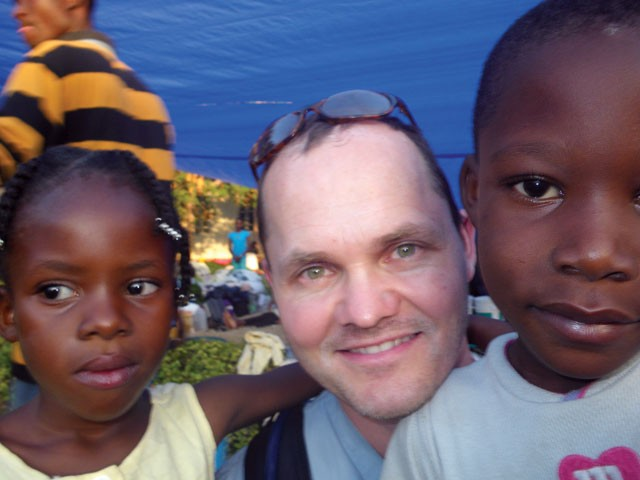 Dr. Mathew Rawlins with two Haitian children in January.