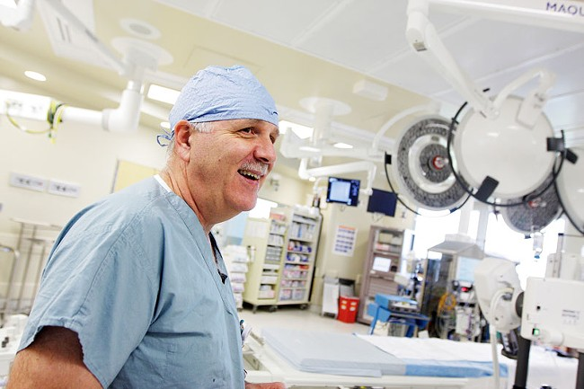 Dr. Michael Ring discusses the clinical trials that have him testing the MedTronic Corevalve in an operating room at Sacred Heart. - YOUNG KWAK