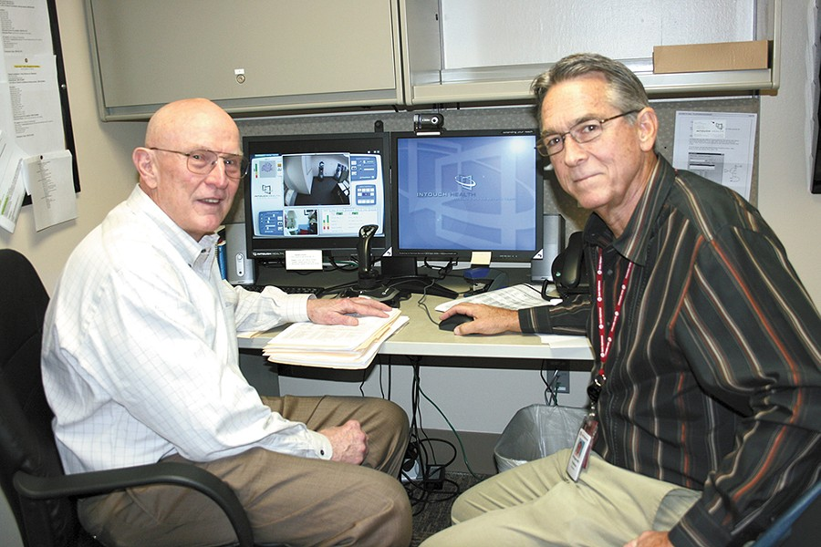 Dr. William Terry (left) and Dr. William Hazle use this terminal to communicate with patients in rural areas. - ST. ALPHONSUS REGIONAL MEDICAL CENTER