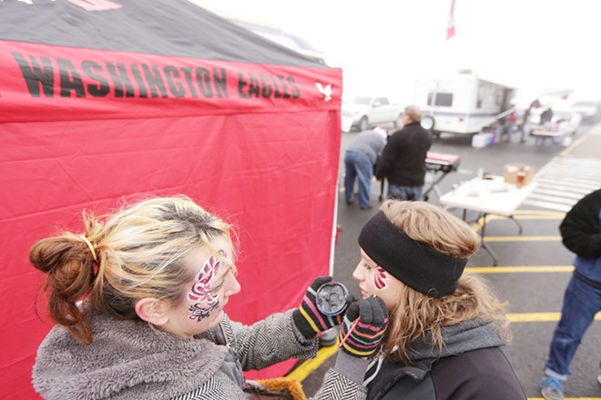 Drew Blincow, left, paints Brianna Duren's face before the game. - YOUNG KWAK