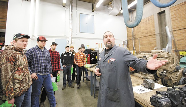 During a tech tour at North Idaho College, Diesel Technology Instructor Tony Christiansen shows a group of high school students options at the institution. - YOUNG KWAK
