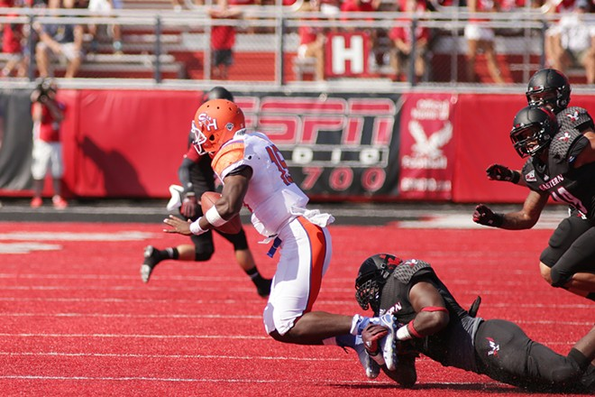 Eastern Washington defensive lineman Samson Ebukam, right, brings down Sam Houston State quarterback Jared Johnson during the second half. - YOUNG KWAK