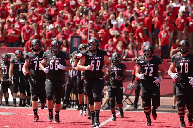 Eastern Washington players run onto the field during the first half. - YOUNG KWAK
