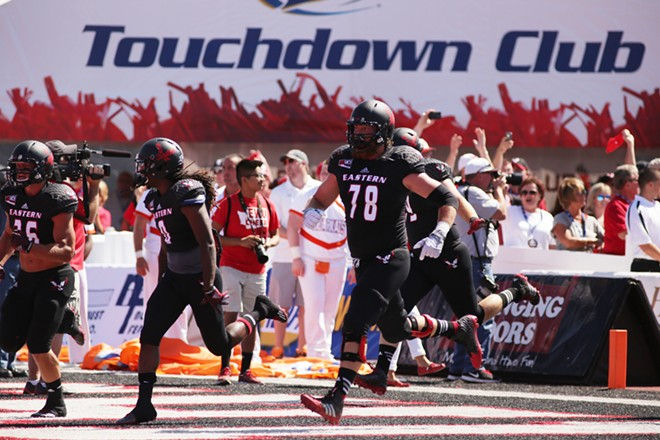Eastern Washington players run out during introductions before the game. - YOUNG KWAK