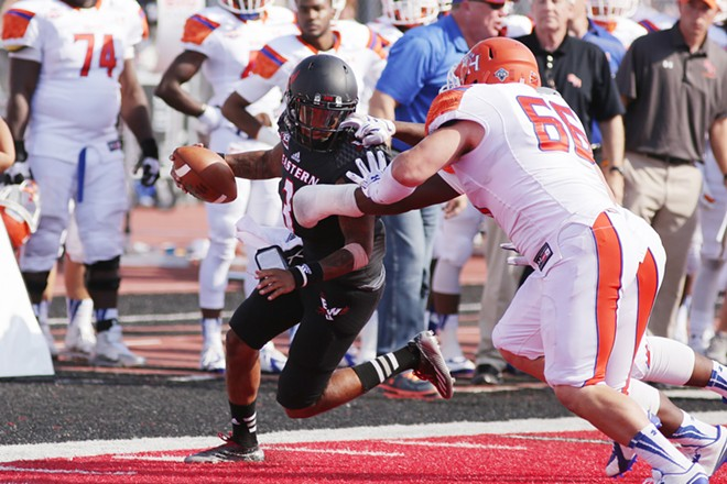 Eastern Washington quarterback Vernon Adams Jr. (3) runs against Sam Houston State defensive lineman Gary Lorance (66) and defensive end P.J. Hall during the second half. - YOUNG KWAK