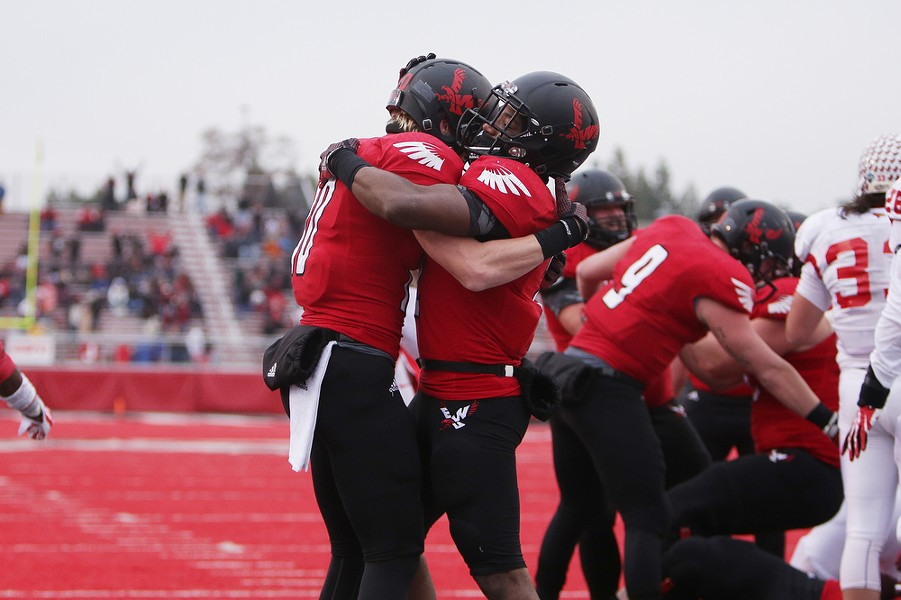 Eastern Washington running back Jabari Wilson, right, celebrates with teammate wide receiver Cooper Kupp during the second half. - YOUNG KWAK