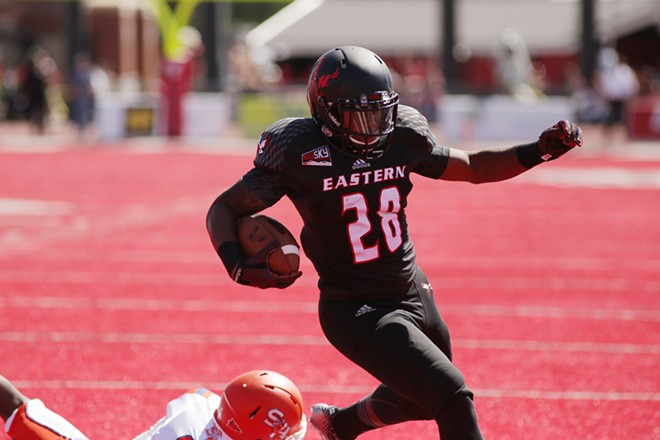 Eastern Washington running back Jalen Moore (28) runs in for a touchdown during the first half. - YOUNG KWAK