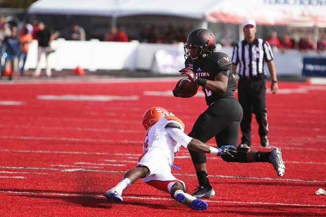 Eastern Washington running back Jalen Moore, right, runs the ball against Sam Houston State cornerback Mikell Everette during the second half. - YOUNG KWAK