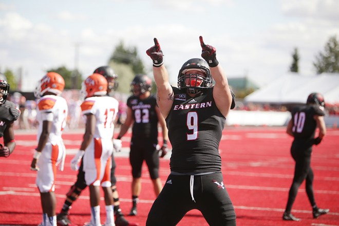 Eastern Washington tight end Zach Wimberly (9) celebrates after running in for a touchdown during the second half. - YOUNG KWAK