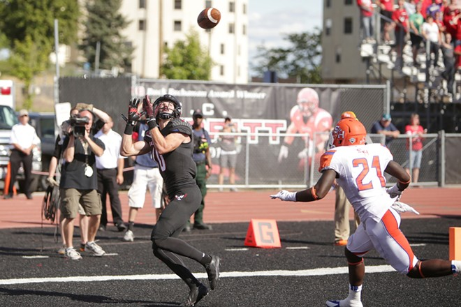 Eastern Washington wide receiver Cooper Kupp catches a pass for a touchdown against Sam Houston State safety Desmond Fite (21) during the second half. - YOUNG KWAK