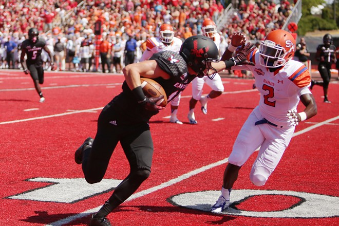 Eastern Washington wide receiver Cooper Kupp, left, is chased down by Sam Houston State safety Michael Wade (2) during the first half. - YOUNG KWAK