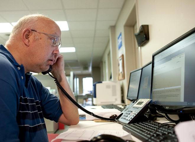Greg Dault, a Spokane volunteer at the Democratic HQ, places a call to a potential voter. As of Sunday, Dault had contacted 20,921 area voters this election cycle.