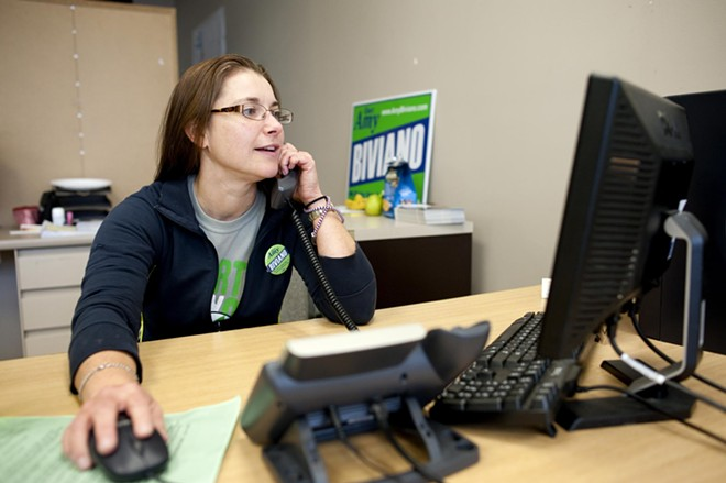 Amy Biviano makes last second calls to voters from the downtown Democratic HQ.