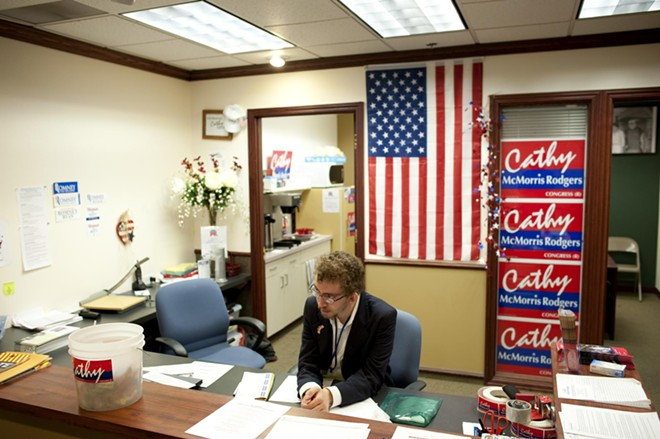 A volunteer mans the front desk at the GOP Victory Center HQ.