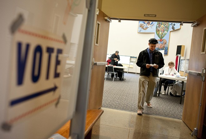 Brian Hoch, of Spokane, leaves the polling station at St. Mark's Lutheran Church after submitting his ballot.