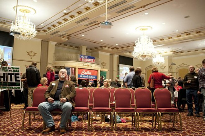 Robin Paullin watches the early election results come in at the Cathy McMorris-Rodgers watch party at the Davenport Hotel Tuesday evening.