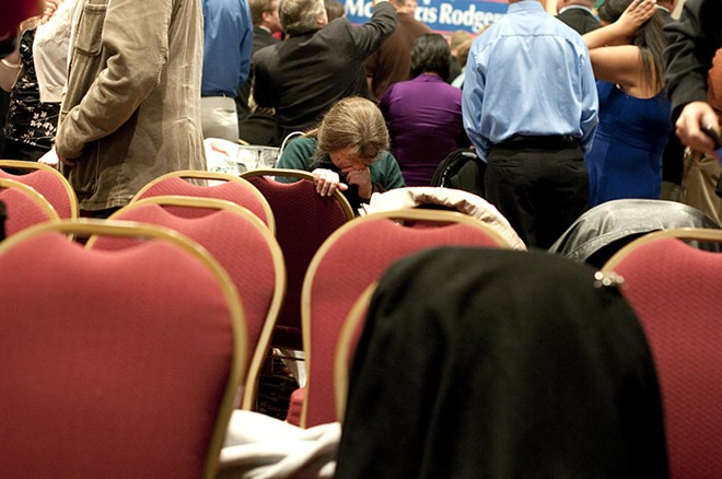A woman takes a moment to compose herself after the news of an Obama re-election at the McMorris-Rodgers GOP watch party at the Davenport Hotel Tuesday evening.