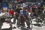 Elite wheelchair racers wait for the start.