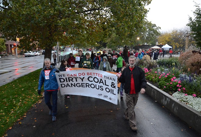 Environmental advocates and community organizers march through Riverfront Park in opposition to increased oil train traffic in Spokane. - JACOB JONES