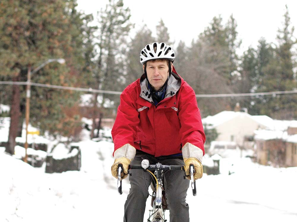Eric Erickson rides his bike on the South Hill - YOUNG KWAK