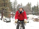 Eric Erickson rides his bike on the South Hill
