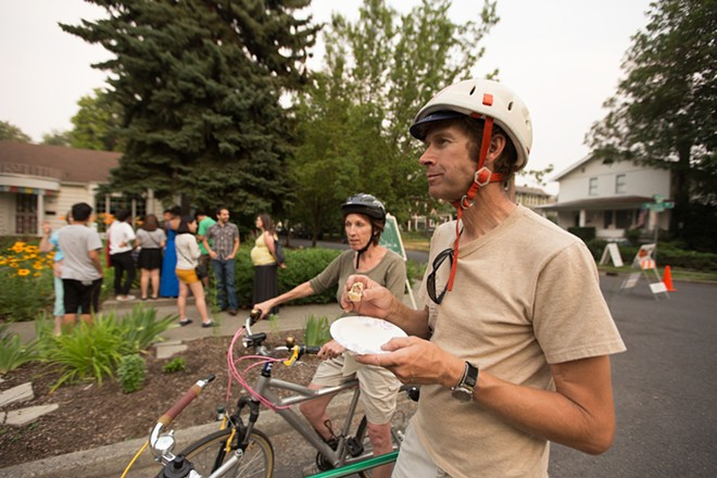 Erick Erickson, right, and Jo Pickens enjoy Tibetan dumplings. - YOUNG KWAK