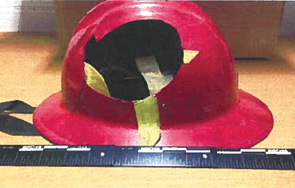 Evidence photos show the damage to Hall's helmet.