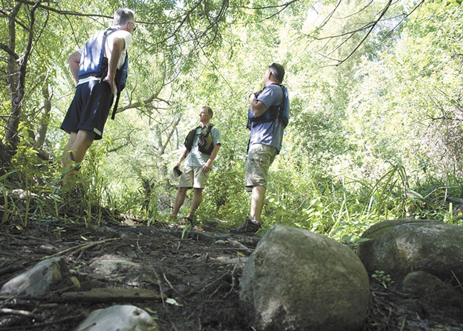 Exploring the river bank during a tour in early September. - JACOB JONES