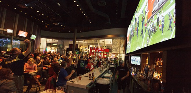 Fans cheer at EPIC during the NFC Championship game that sent the Seahawks to the Super Bowl. - YOUNG KWAK
