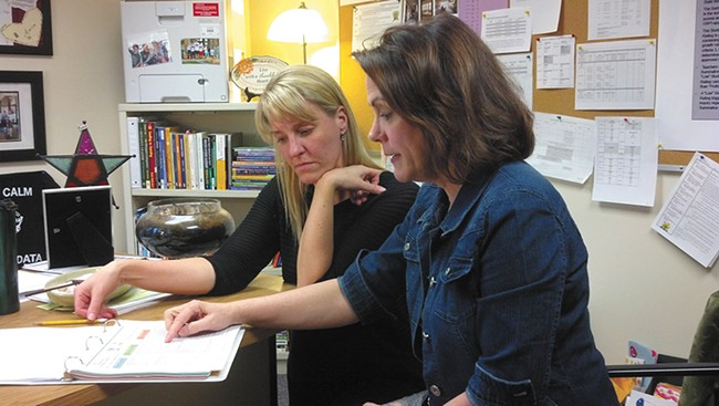 Finch Elementary Principal Kim Harmon (left) and second-grade teacher Theresa Luciani work together using the district's new, more rigorous teacher evaluation system. - DANIEL WALTERS