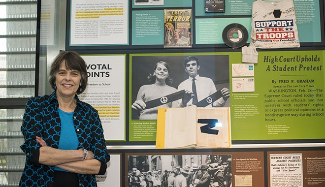 Mary Beth Tinker at the Newseum in Washington, D.C., with the display about her 1969 Supreme Court case. - MARIA BRYK/TINKER TOUR