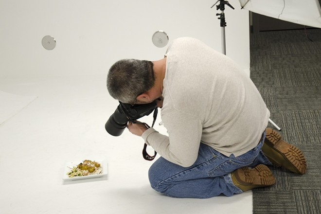 Inlander photographer Young Kwak photographs one of many Restaurant Week dishes in our studio this afternoon — lots of delicious food photos headed your way. - LISA WAANANEN