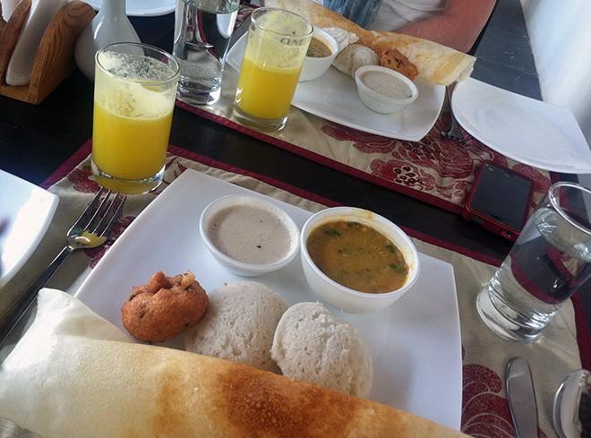 Breakfast in Pondicherry: Samosa, vada, idly, pineapple juice. - LISA WAANANEN