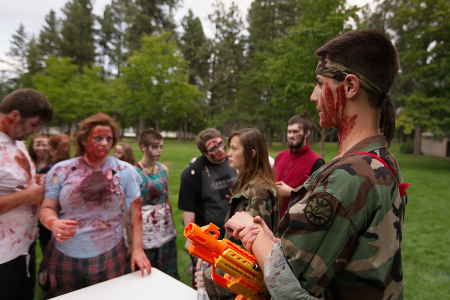 Founder Adin Haines, right, speaks with zombies and other volunteers. - YOUNG KWAK