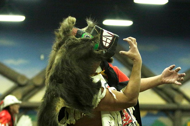 Frank Brown, of the Tlingit and Haida Indian Tribes of Alaska, dances in clothing honoring the Bear Clan. - YOUNG KWAK