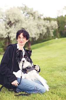 From stray dog to life-saving companion: Jamie Brannock with Misty. - YOUNG KWAK