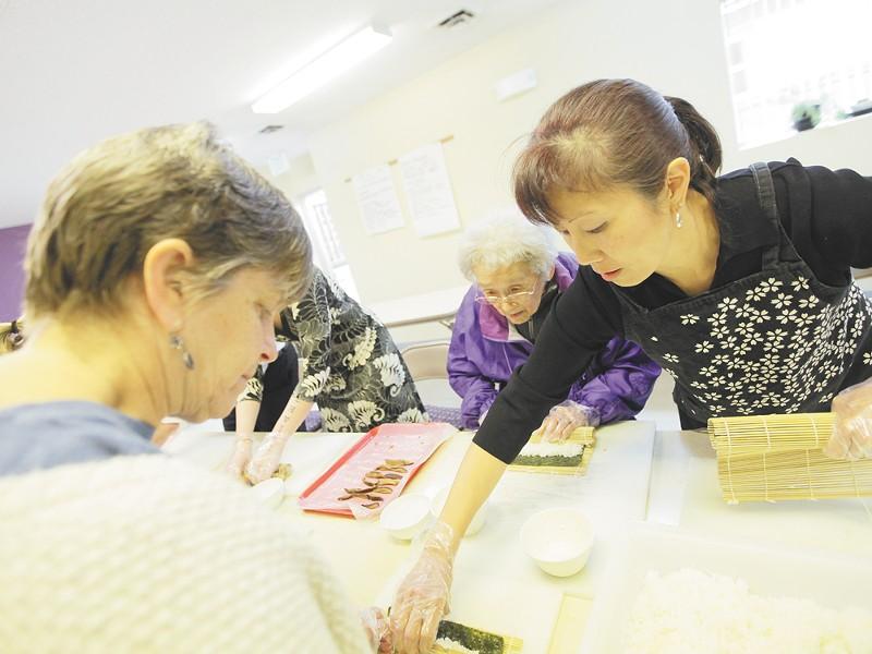 Fumi Uyeji, 87, applies her time-honed sushi-rolling skills at the Spokane Buddhist Temple. - YOUNG KWAK