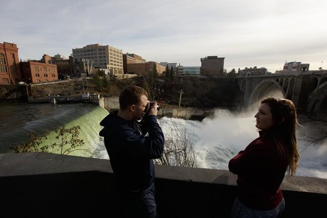 Garrett Frederick, left, photographs the Spokane Falls as Samantha Brady watches. - YOUNG KWAK