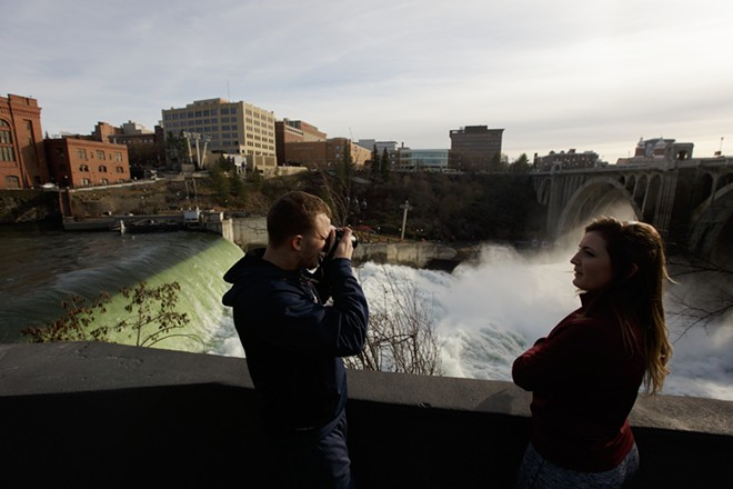 Garrett Frederick, left, photographs the Spokane Falls as Samantha Brady watches. - YOUNG KWAK