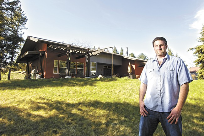 Gavin Tenold, the owner and general contractor of Pura Vida High Performance Builders, stands outside of an energy-efficient house he completed in Spokane. - YOUNG KWAK