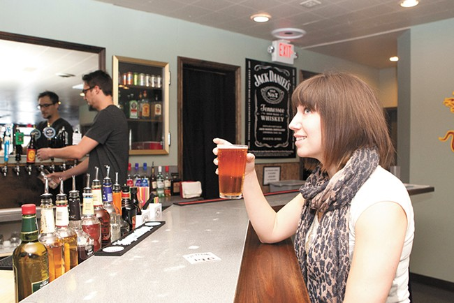Gina Thompson enjoys a cold one at the Flying Pig Pub. - MEGHAN KIRK