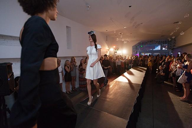 Ginger Ewing, left, passes Jessica Bohnhof on the runway. - YOUNG KWAK