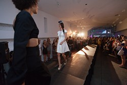 Ginger Ewing, left, passes Jessica Bohnhof on the runway. - YOUNG KWAK