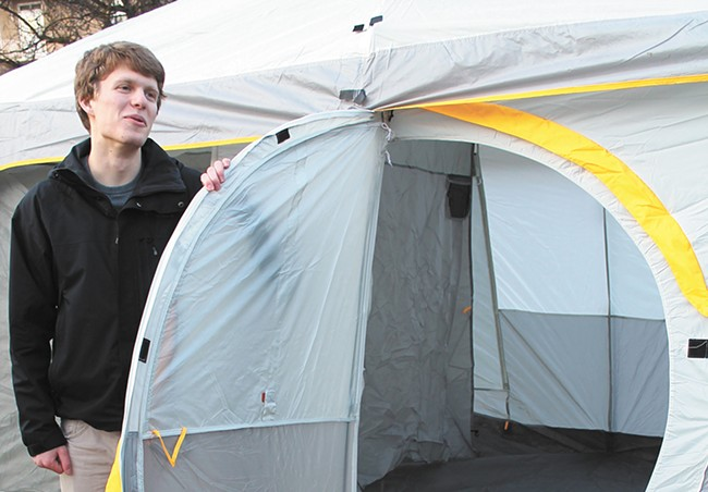Gonzaga freshman Jake Sahli shows off the spacious tent he and friends spent a few cold nights in to get close to the action in the MacCarthey Athletic Center.