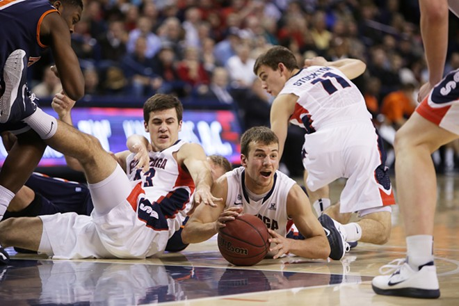 Gonzaga University's Kevin Pangos, center, grabs a loose ball during the second half of an NCAA basketball game against Pepperdine University at the McCarthy Athletic Center on Feb. 7. Gonzaga won 82-56. - YOUNG KWAK